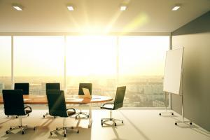 Modern conference room with furniture and city view at sunrise
